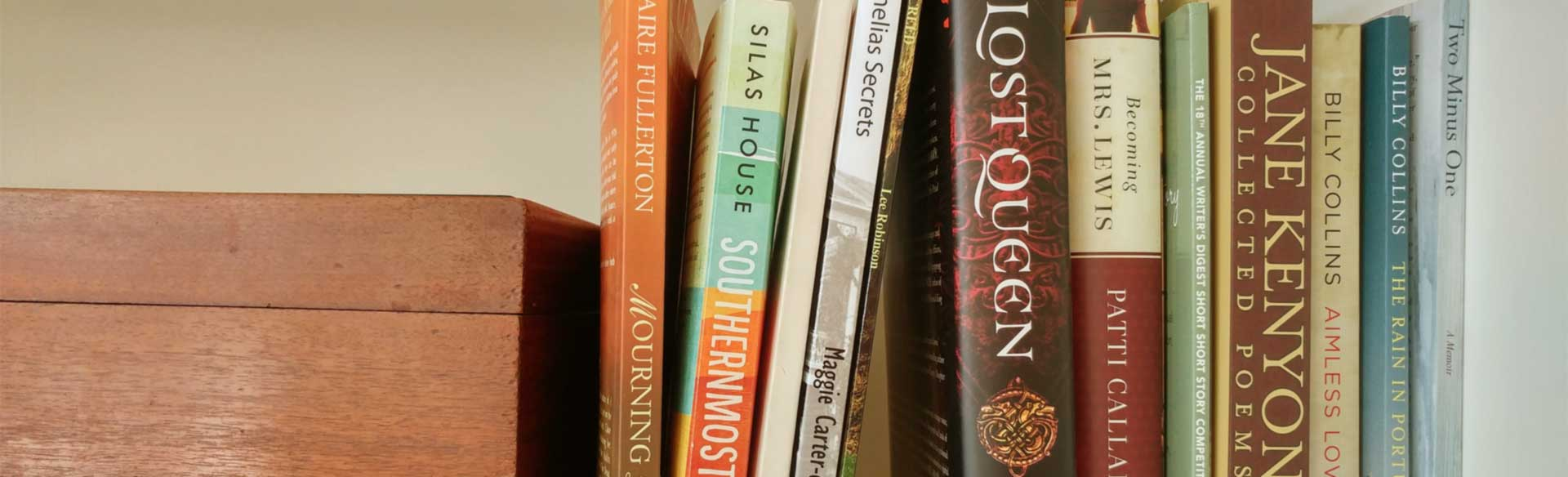 Books on a shelf by Charleston area authors